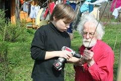 jongen en grootvader Stock Afbeelding
