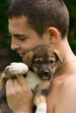Jongen en hij is hond Stock Fotografie