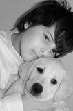 Jongen en hond Stock Afbeelding