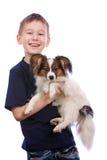 Jongen en kleine hond Royalty-vrije Stock Fotografie