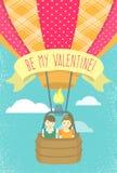 Jongen en meisje in liefde in een hete luchtballon Stock Afbeeldingen