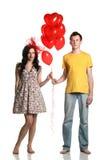 Jongen en meisje met ballons royalty-vrije stock fotografie