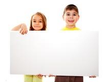 Jongen en meisje met een banner Royalty-vrije Stock Fotografie