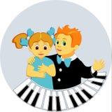 Jongen en meisje in piano Stock Afbeelding