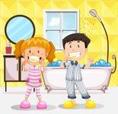 Jongen en meisjes het borstelen tanden in de badkamers royalty-vrije illustratie