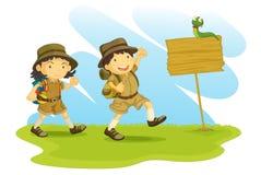 Jongen en padvindster vector illustratie