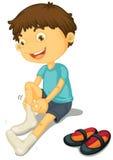 Jongen en schoenen Stock Afbeelding