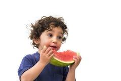 Jongen en watermeloen Stock Foto