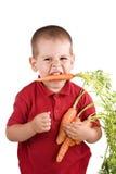 Jongen en wortel Stock Afbeelding
