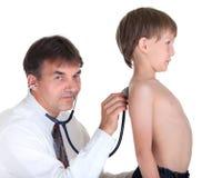 Jongen en zijn arts Stock Foto