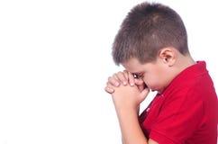 Jongen het bidden Stock Foto