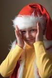Jongen in het kostuum open gezicht van de Kerstman. Stock Foto