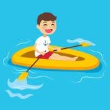 Jongen het roeien boot Royalty-vrije Stock Foto's