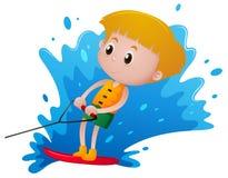 Jongen het spelen waterski Stock Afbeeldingen