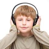 Jongen in hoofdtelefoons Stock Foto