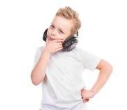 Jongen in hoofdtelefoons Stock Foto's