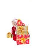 Jongen in Kerstmiskleren met speelgoed stock afbeelding