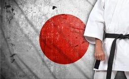 Jongen in kimono en de vlag van Japan Royalty-vrije Stock Afbeeldingen