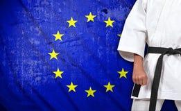 Jongen in kimono en Europese Unie vlag Royalty-vrije Stock Afbeelding