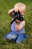 Jongen met camera Stock Afbeelding