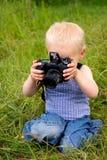 Jongen met camera Stock Fotografie