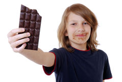 Jongen met chocolade Stock Afbeeldingen