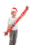Jongen met de banner van Kerstmis stock foto's