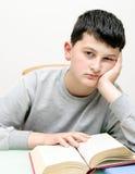 Jongen met een boek Stock Foto's