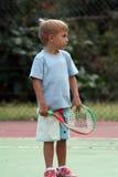 Jongen met een racket Stock Foto