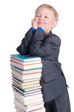 Jongen met een stapel van boeken Stock Fotografie