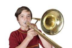 Jongen met een trombone royalty-vrije stock afbeelding