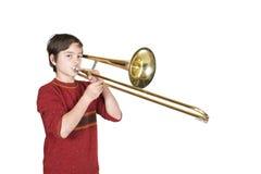 Jongen met een trombone stock fotografie