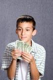 Jongen met Geld stock afbeelding