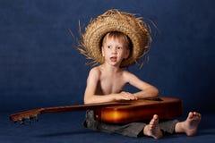 Jongen met gitaar Royalty-vrije Stock Afbeeldingen