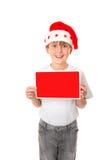 Jongen met het Bericht van Kerstmis stock foto