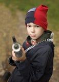 Jongen met het geweer Royalty-vrije Stock Afbeeldingen