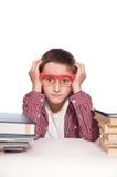 Jongen met het leren van moeilijkheid Stock Foto's