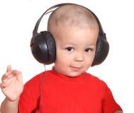 Jongen met hoofdtelefoons Stock Afbeeldingen