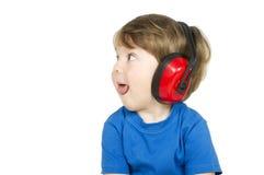 Jongen met hoofdtelefoons. Stock Afbeeldingen