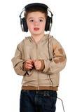 Jongen met hoofdtelefoons Stock Foto
