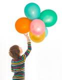 Jongen met kleurrijke ballons Stock Foto