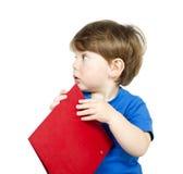 Jongen met notitieboekje. Stock Afbeeldingen