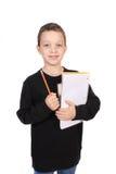 Jongen met notitieboekje en potlood stock afbeelding