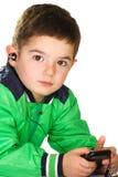 Jongen met oortelefoon Stock Fotografie