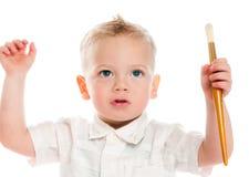Jongen met painbrush Stock Foto