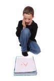 Jongen met perfect schoolteken Stock Fotografie