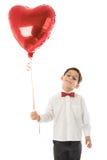 Jongen met rode ballon Stock Foto