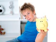 Jongen met spaarvarken Stock Afbeelding