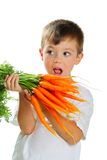 Jongen met wortelen Royalty-vrije Stock Foto