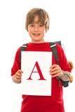 Jongen met zijn goed schoolrapport Royalty-vrije Stock Afbeelding